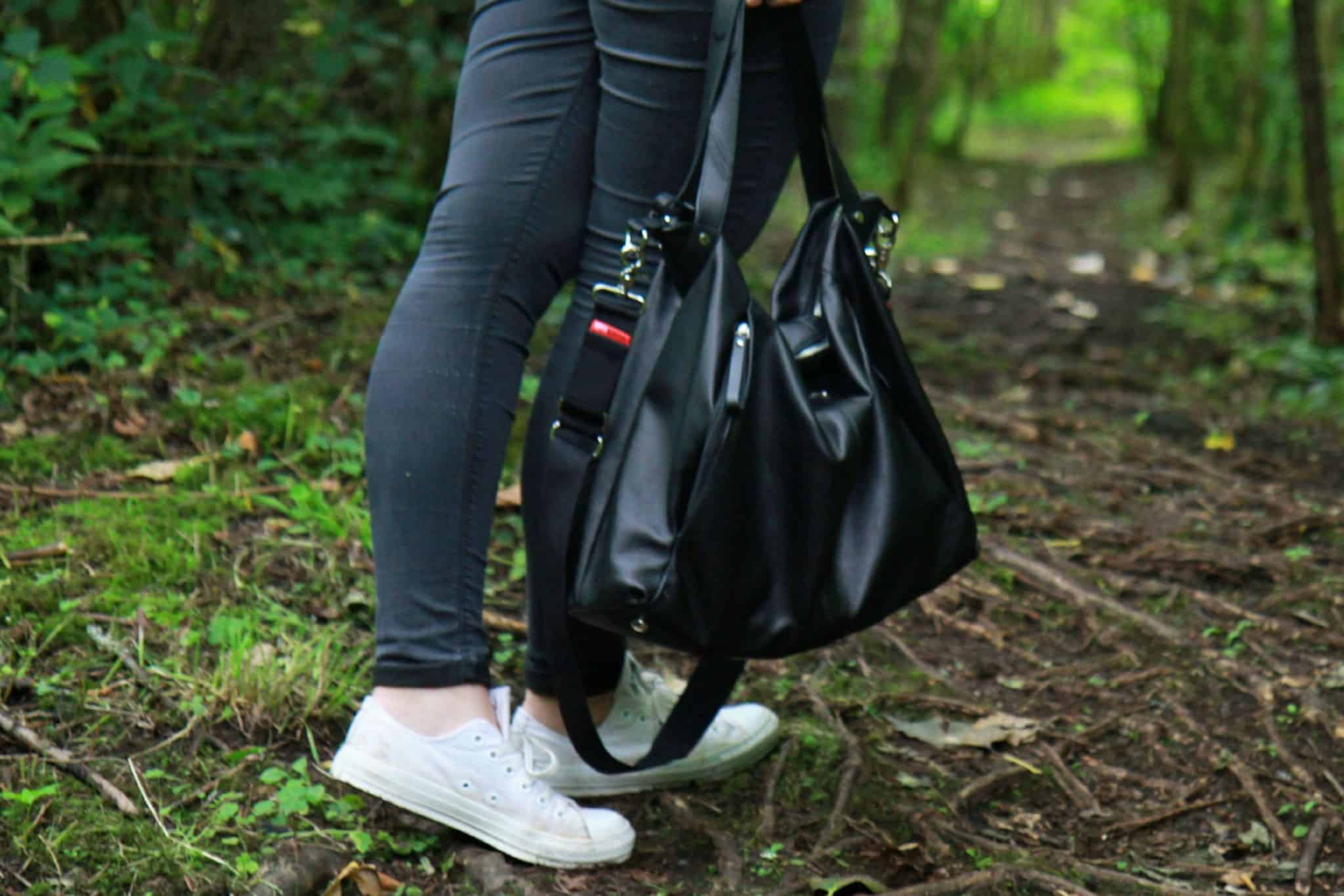 Wearing black topshop jeans, white converse and Storksak change bag