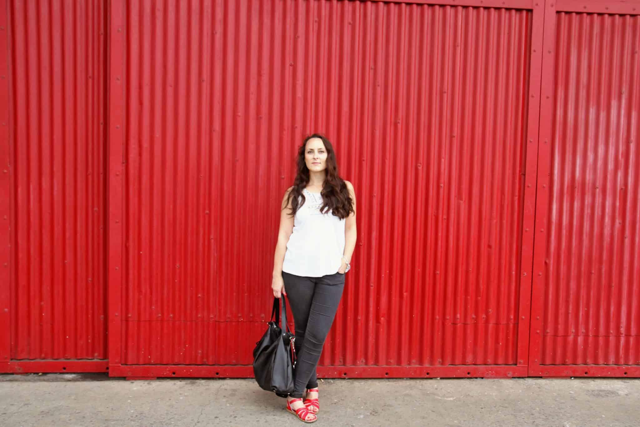 Wearing black topshop jeans, red saltwater sandals and Storksak Catherine bag in black