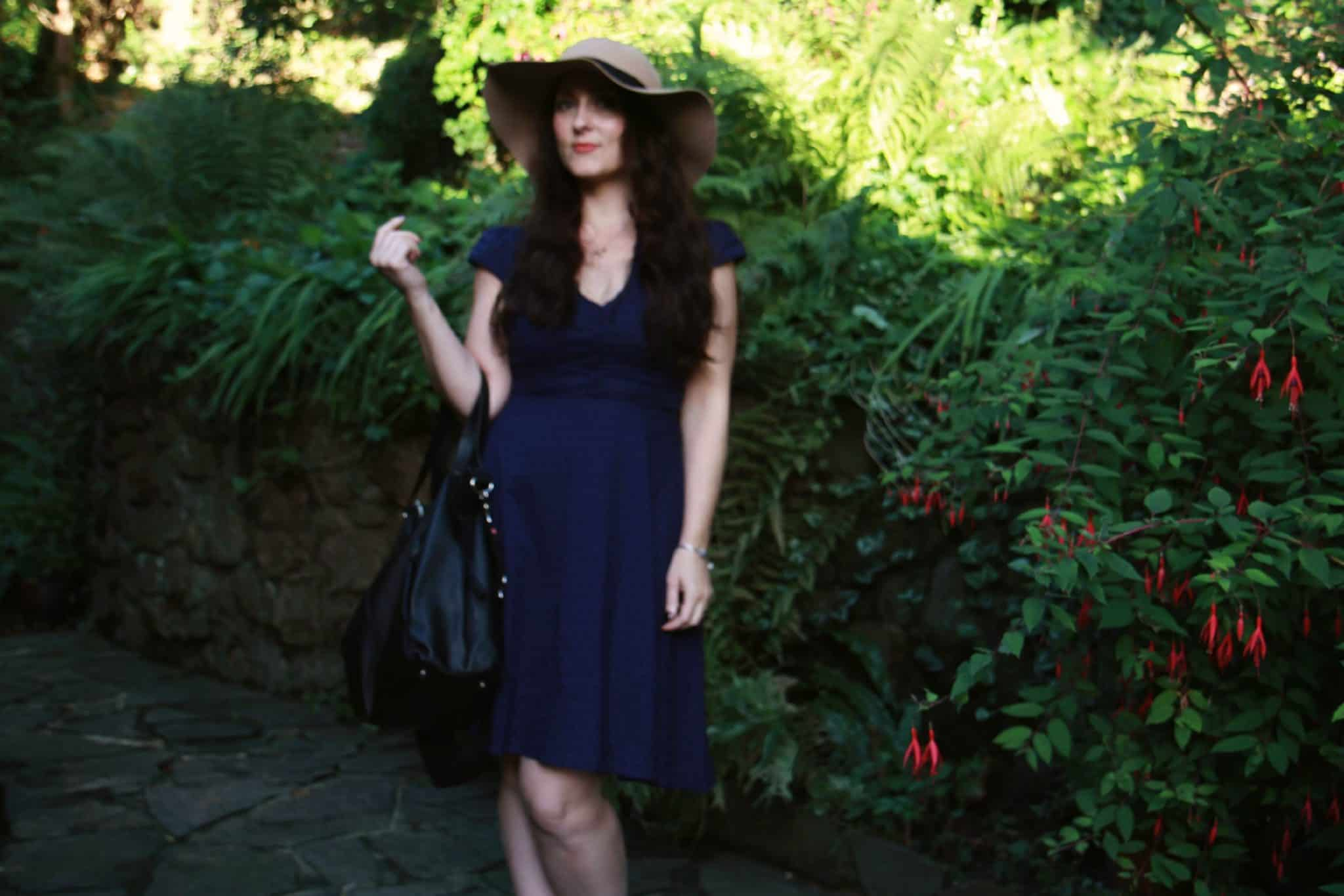storksak bag teamed with dress from Fever London and Topshop floppy hat