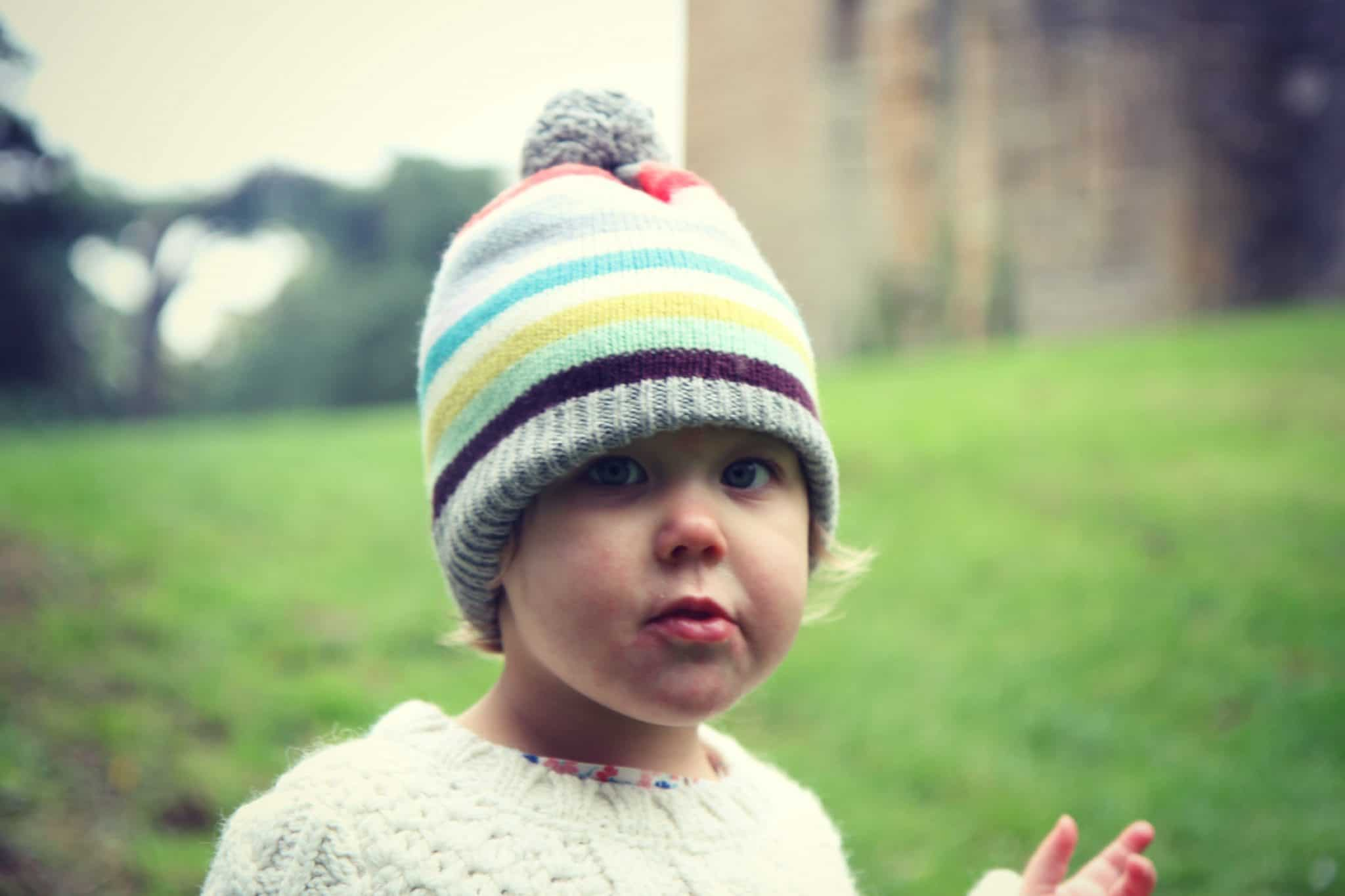 Picture of a little girl in a stripy hat