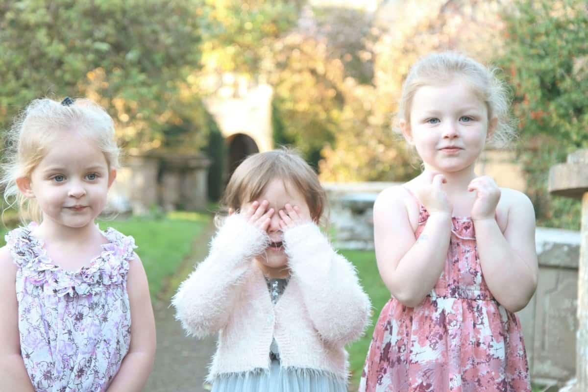 3 girls in a churchyard