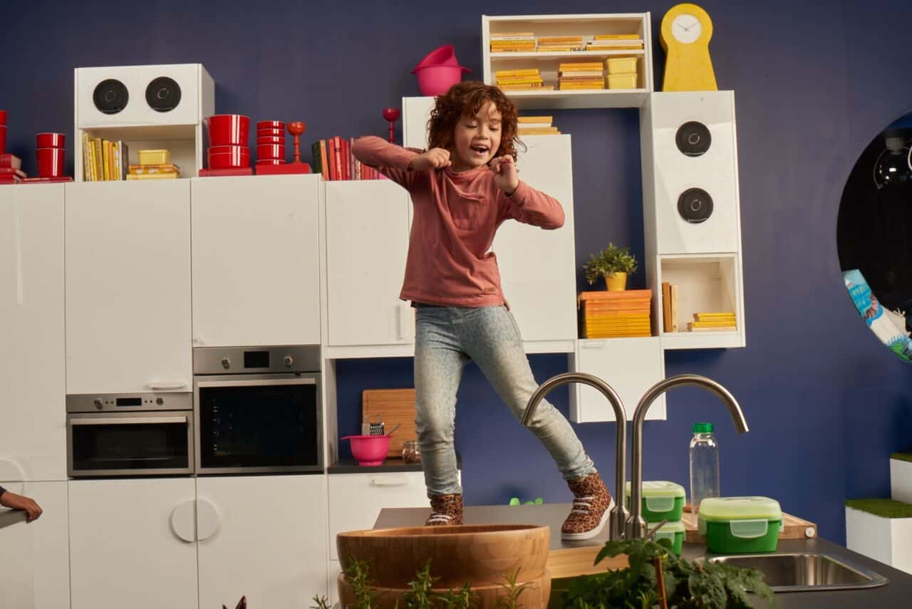 Picture of kid dancing on the top of Ikea kitchen worktop!