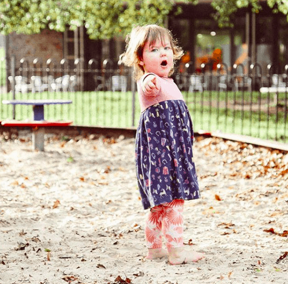Little girl in the sandpit at the park