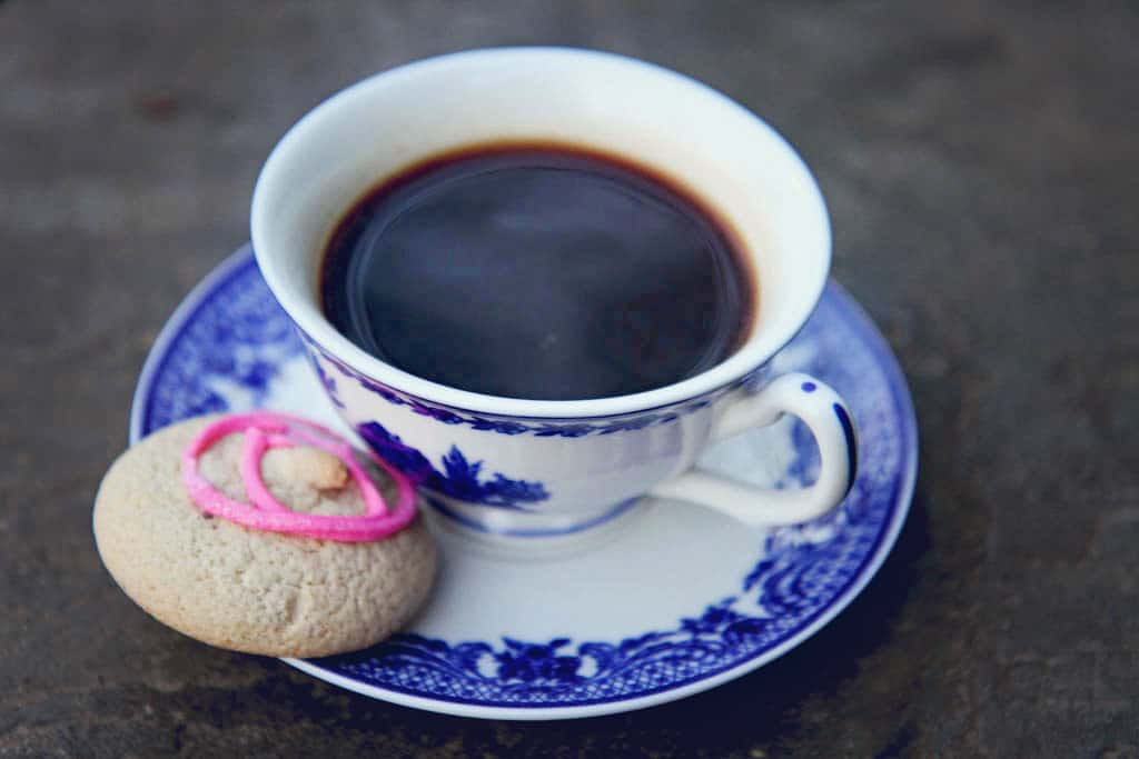 Black coffee and a traditional sweet Maltese biscuit