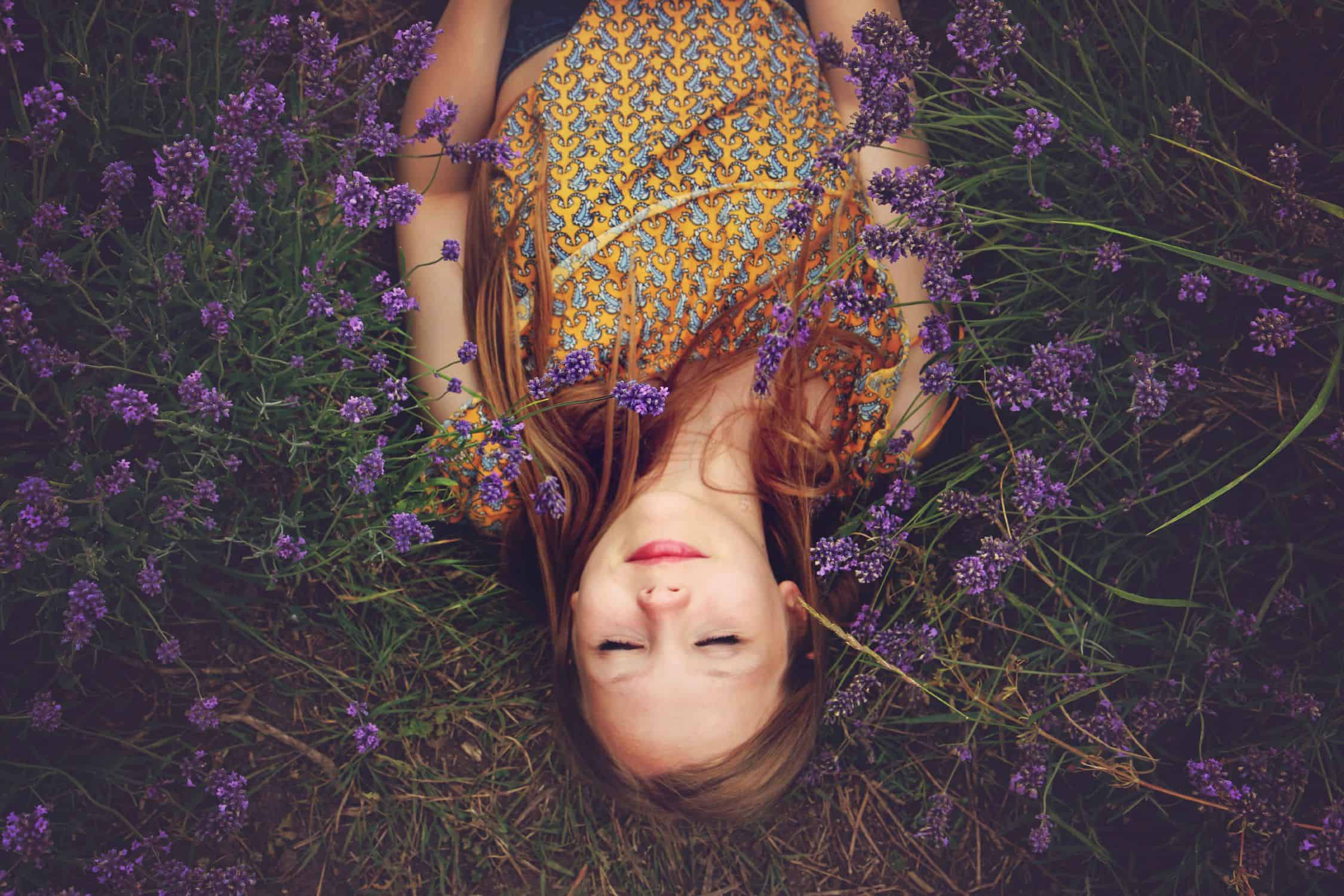 Girl lying in a field of lavender