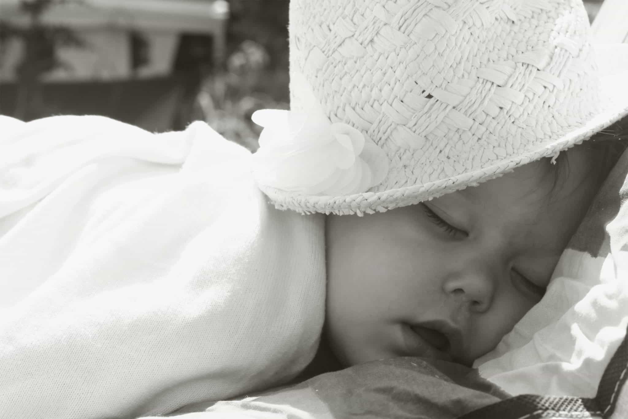 Toddler asleep in the sunshine