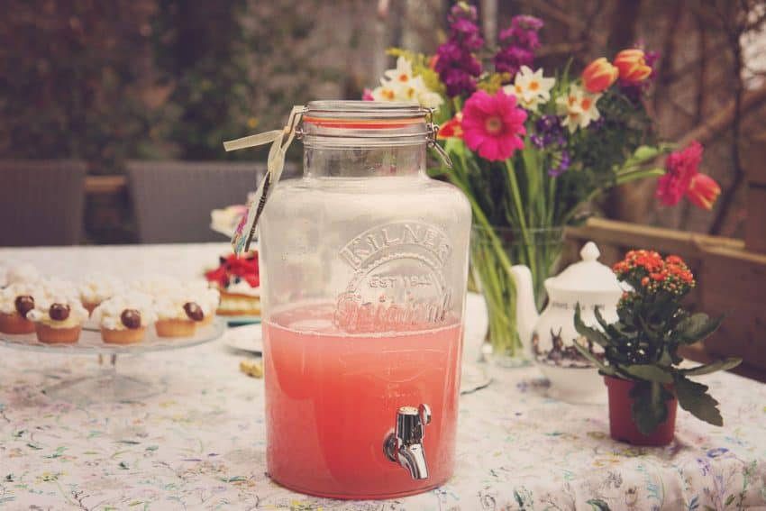 Kilner drinks dispenser filled with pink lemonade at an Alice in Wonderland themed tea party