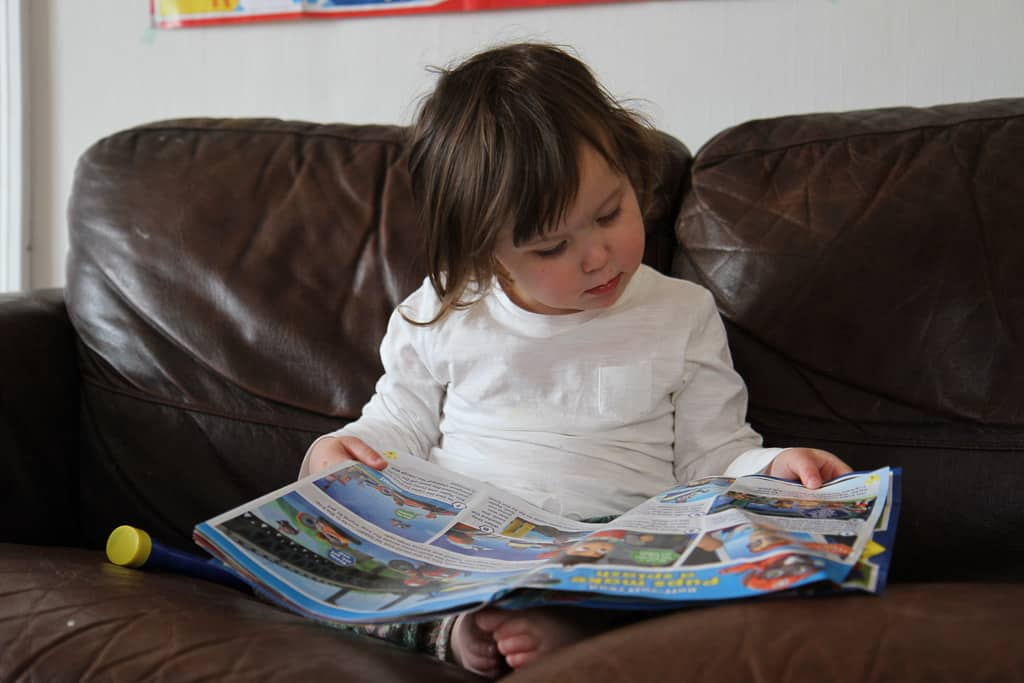 Reading a Paw Patrol magazine from Egmont publishing