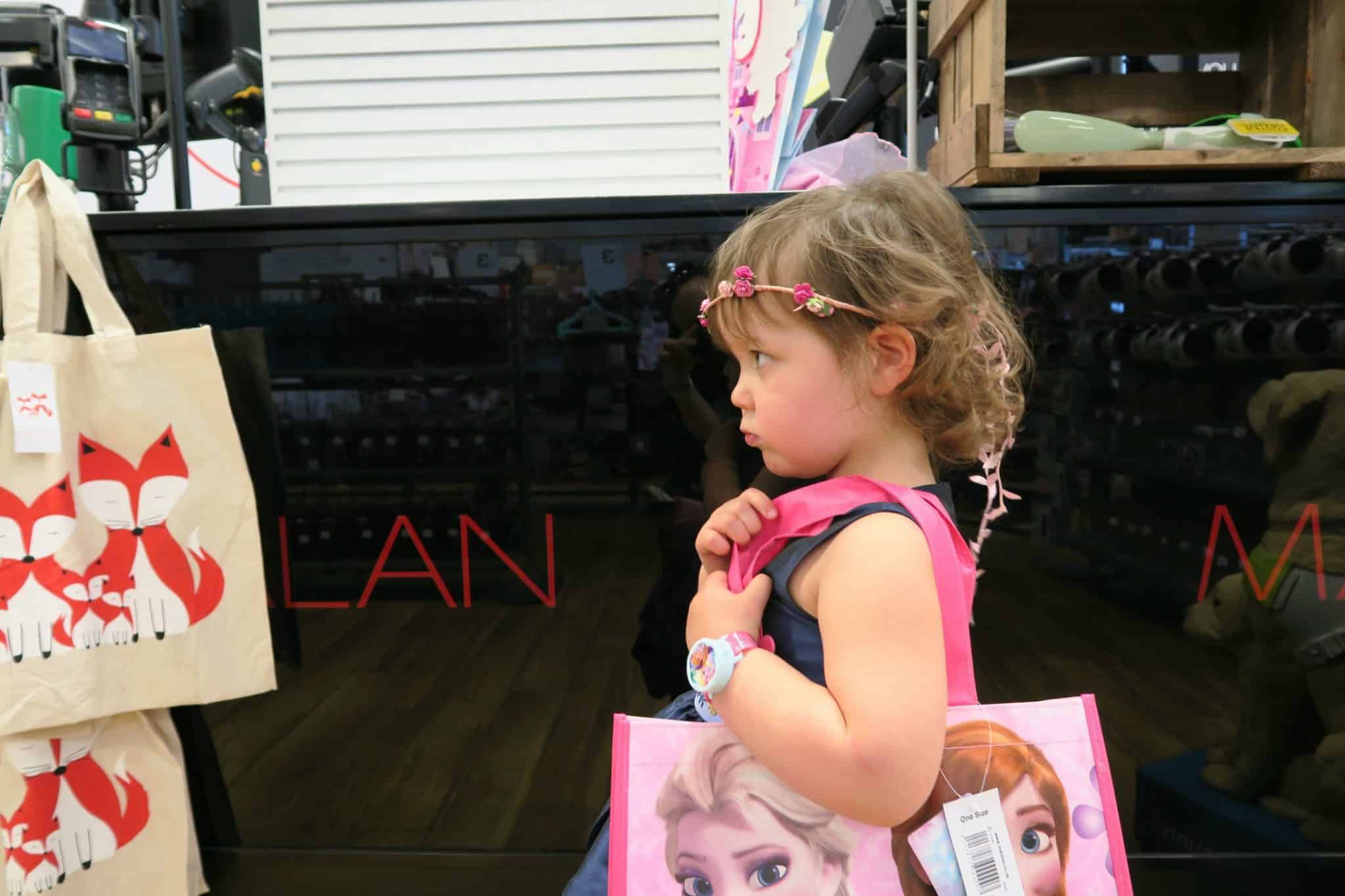 Little girl out shopping