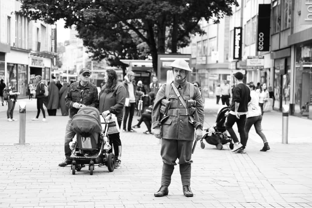 A man dressed as a WW1 soldier form the battle of the Somme stands in the middle o f a packed shopping centre in Bristol
