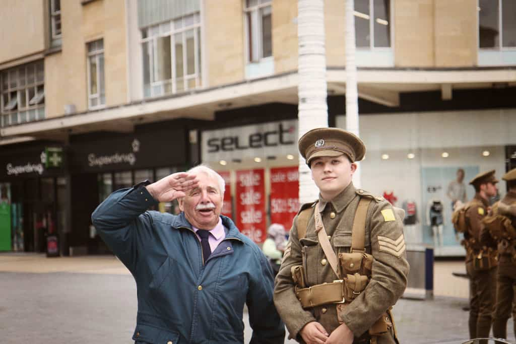 A man salutes the soldiers saying 'I was a soldier once, you know""