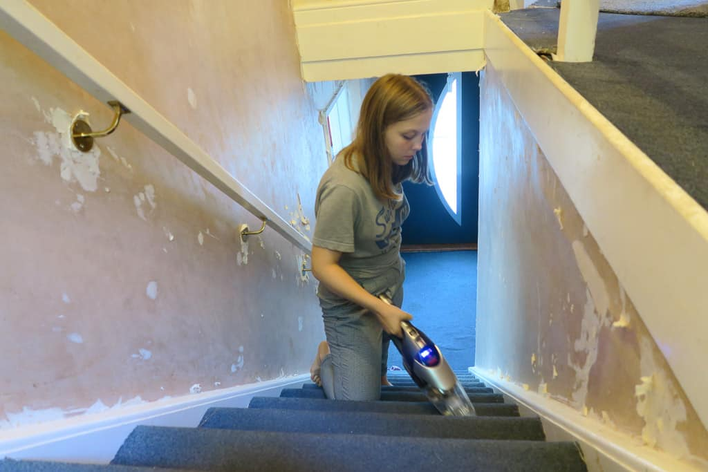 Cleaning the stairs with handheld BISSELL 2-IN-1 Cordless vacuum