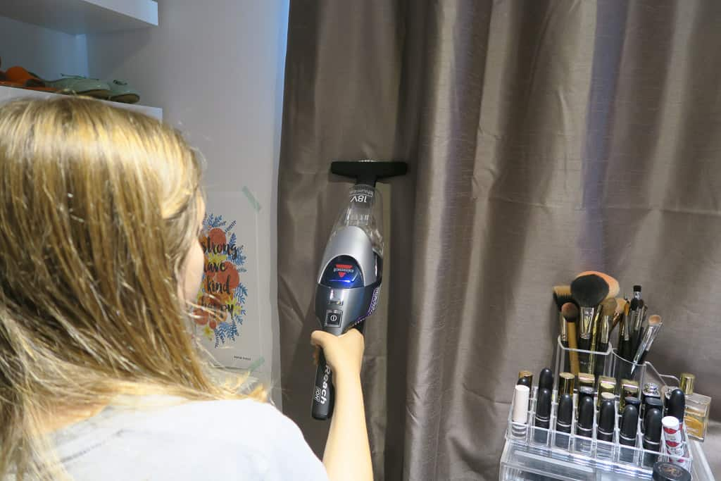 vacuuming curtains with the BISSELL 2-IN-1 Cordless vacuum
