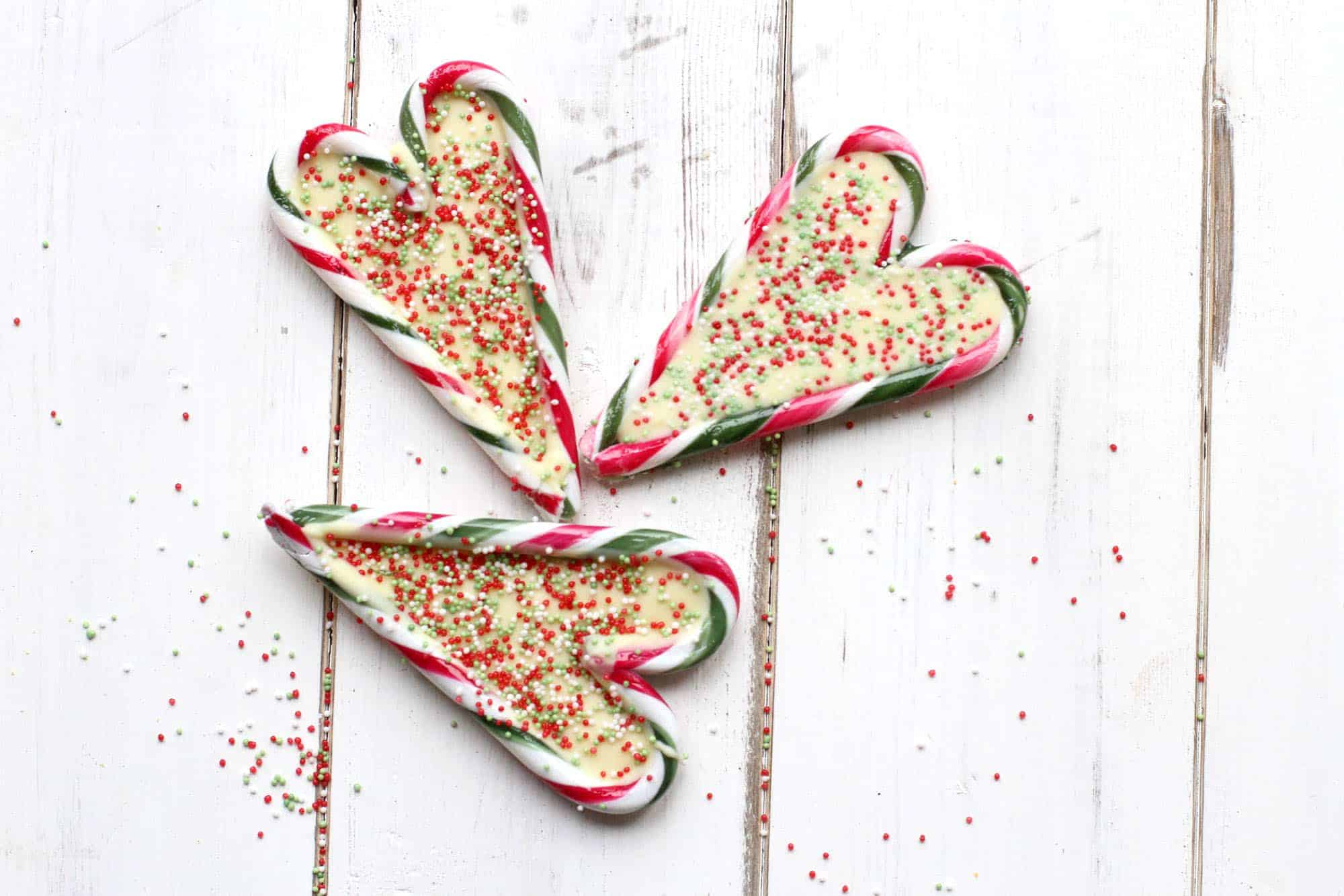 Candy cane peppermint hearts filled with a white chocolate centre and decorated with festive sprinkles