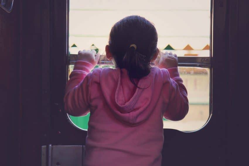 Little girl on steam train