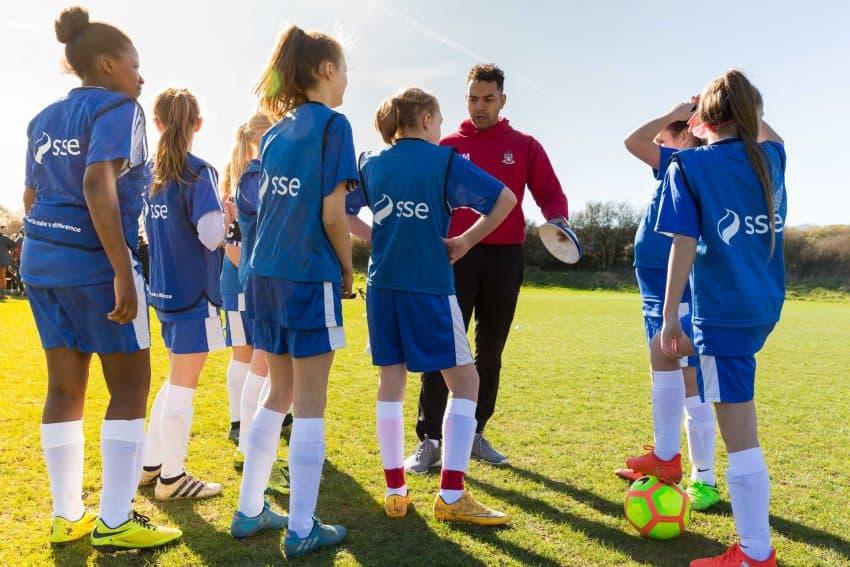Team of girls playing football