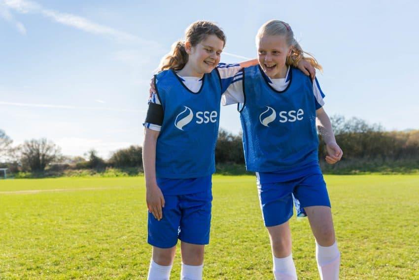 two girls playing football