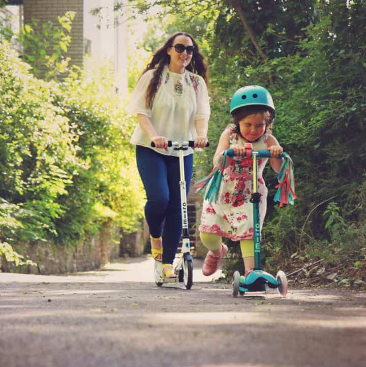 Mother and daughter riding Micro Scooters