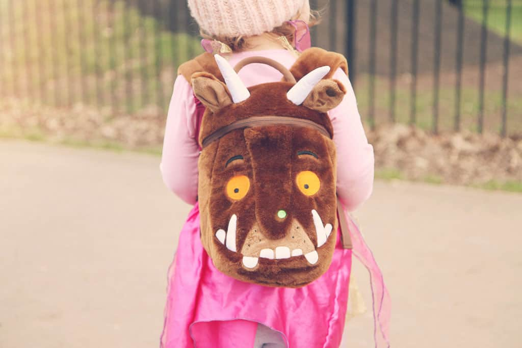 Little girl wearing a gruffly backpack