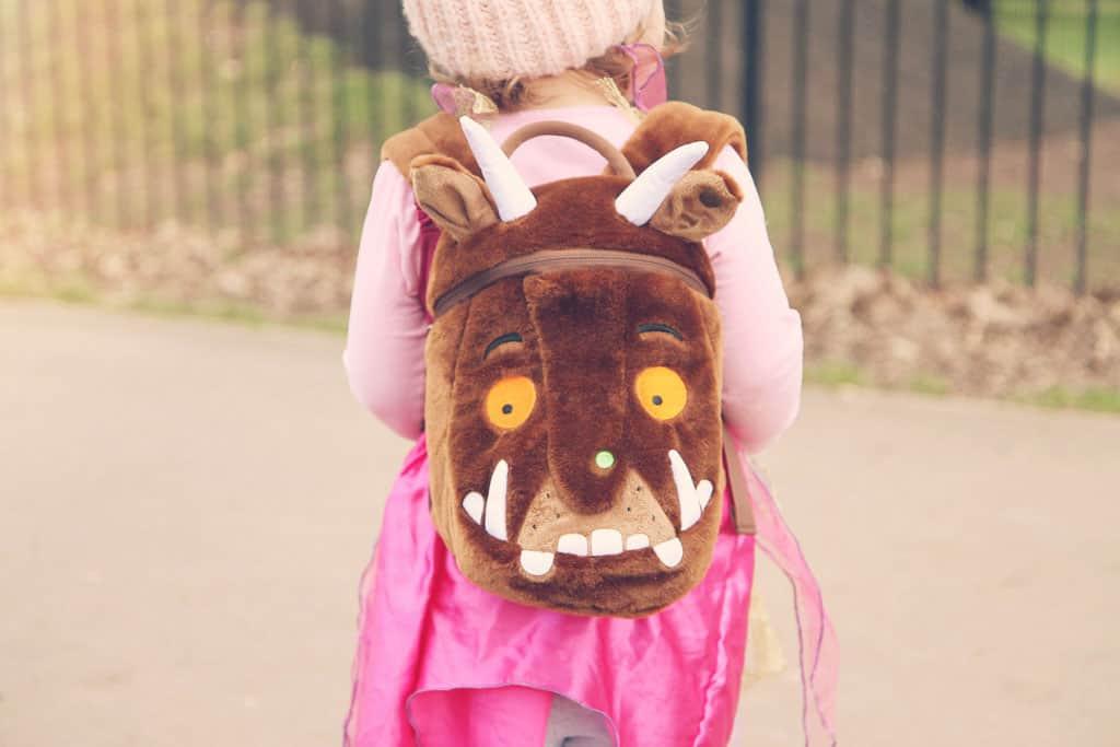 Little girl wearing a gruffly backpack