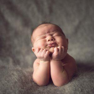 Baby sleeping in Angel pose