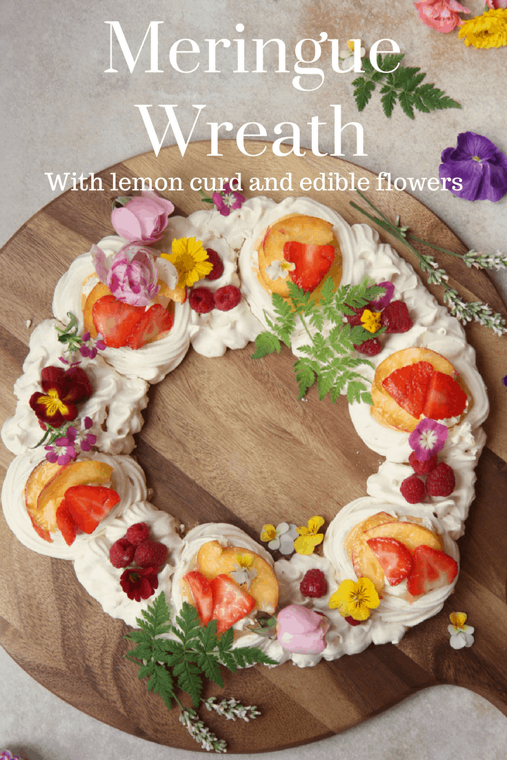 A meringue nest sharing wreath filled with lemon curd and decorated with seasonal edible flowers. Click the link for the simple recipe.