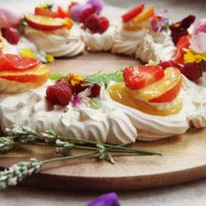 Beautifully decorated meringue wreath with edible flowers