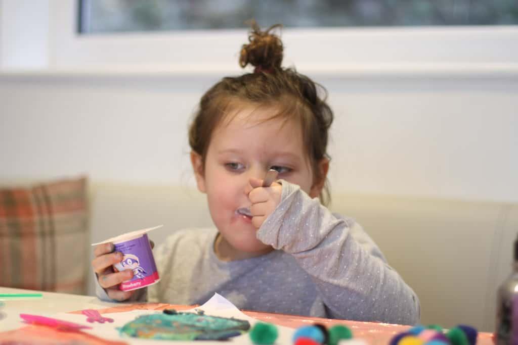 Toddler enjoying Petits Filous