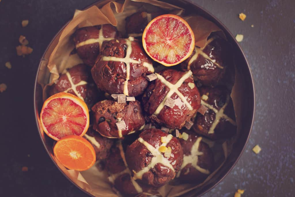 Double chocolate orange hot cross buns in a tin
