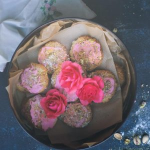 eggless coconut macaroons with rose icing and pistachios