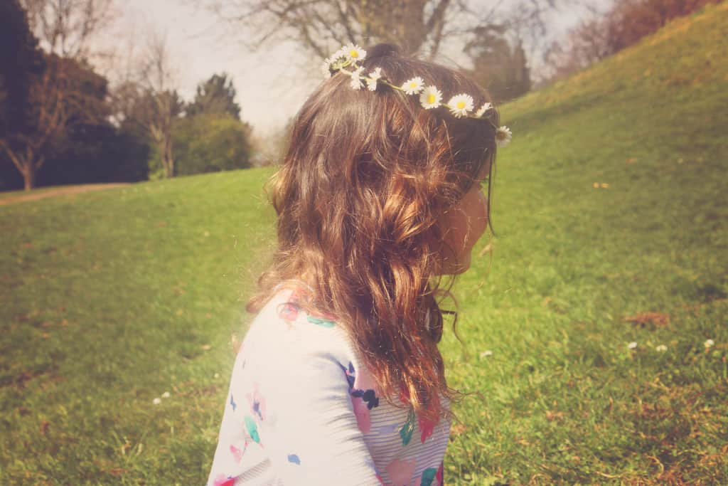 Little girl with a daisy chain