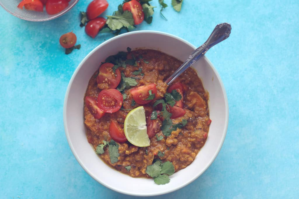 Sweet potato, coconut and tomato dahl in a bowl