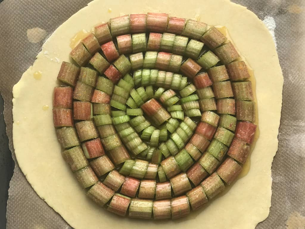 Spiral pattern on rhubarb on top of a pastry disc