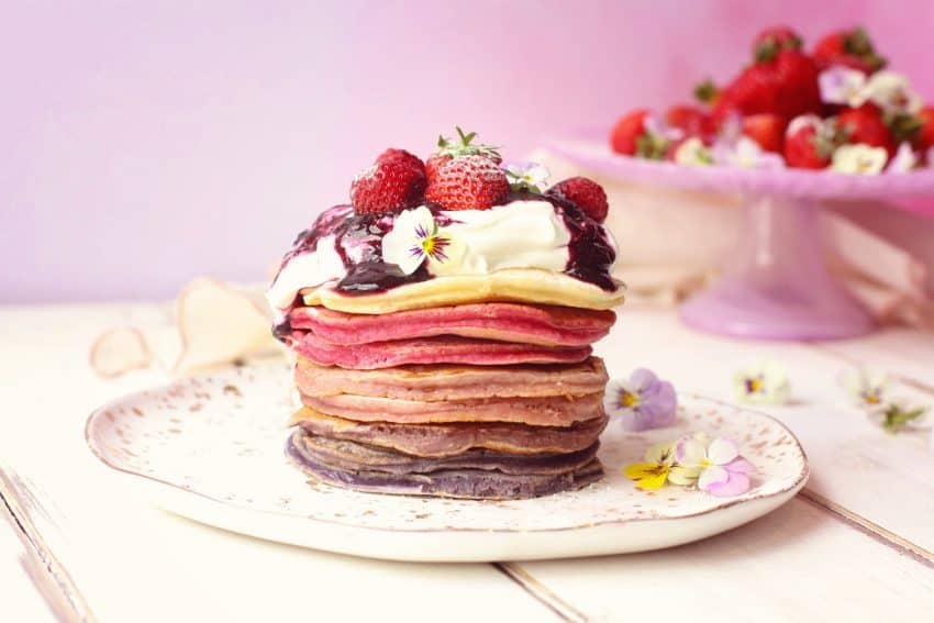Ombré berry pancake stack with fresh fruit