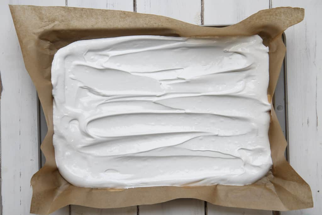 A swiss roll tin with meringue mixture