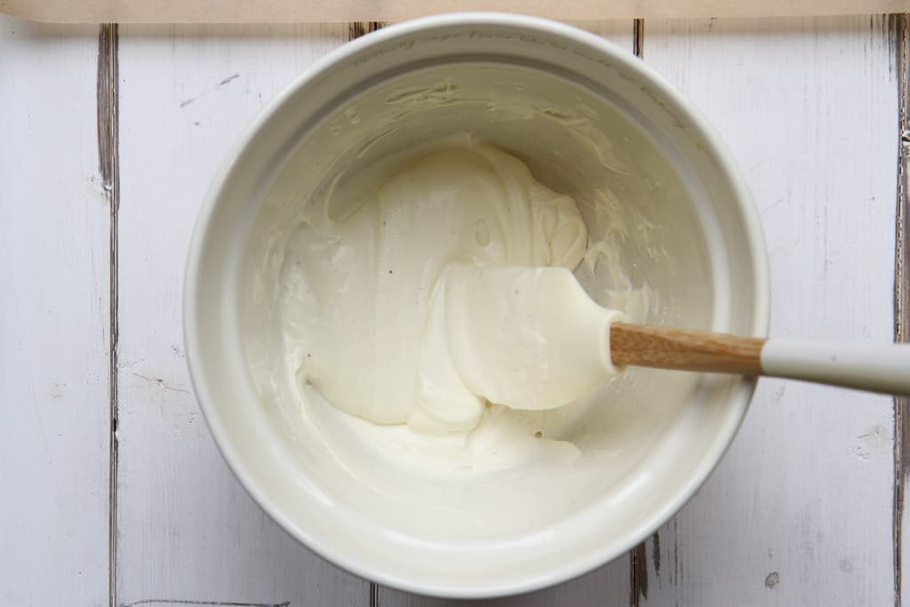 A mixing bowl with whipped cream and vanilla yoghurt