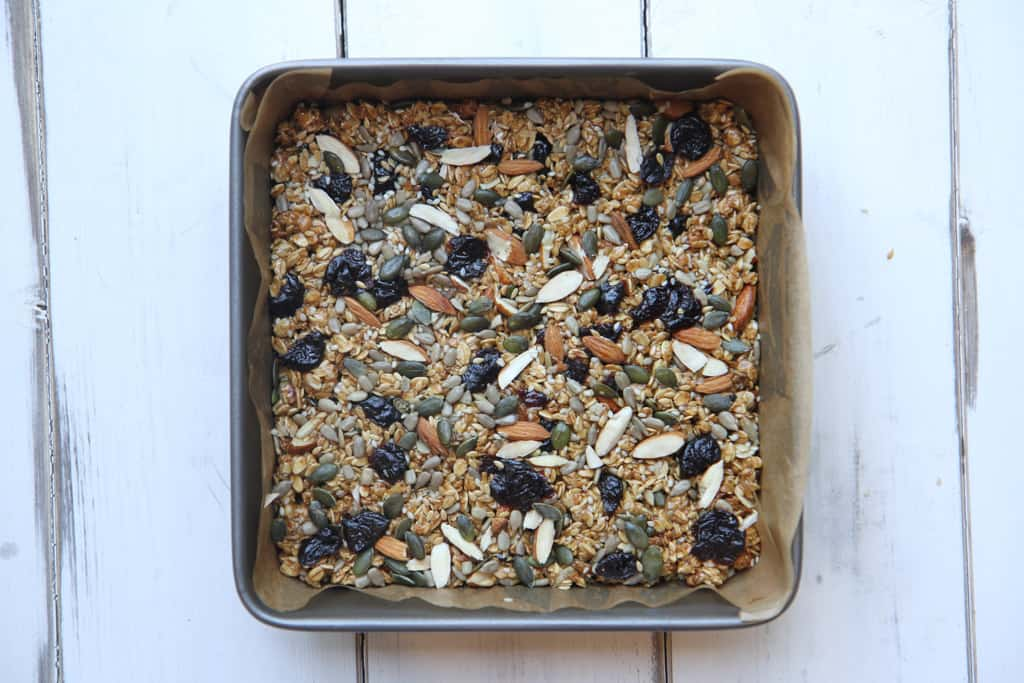 A square tin with granola bar mixture