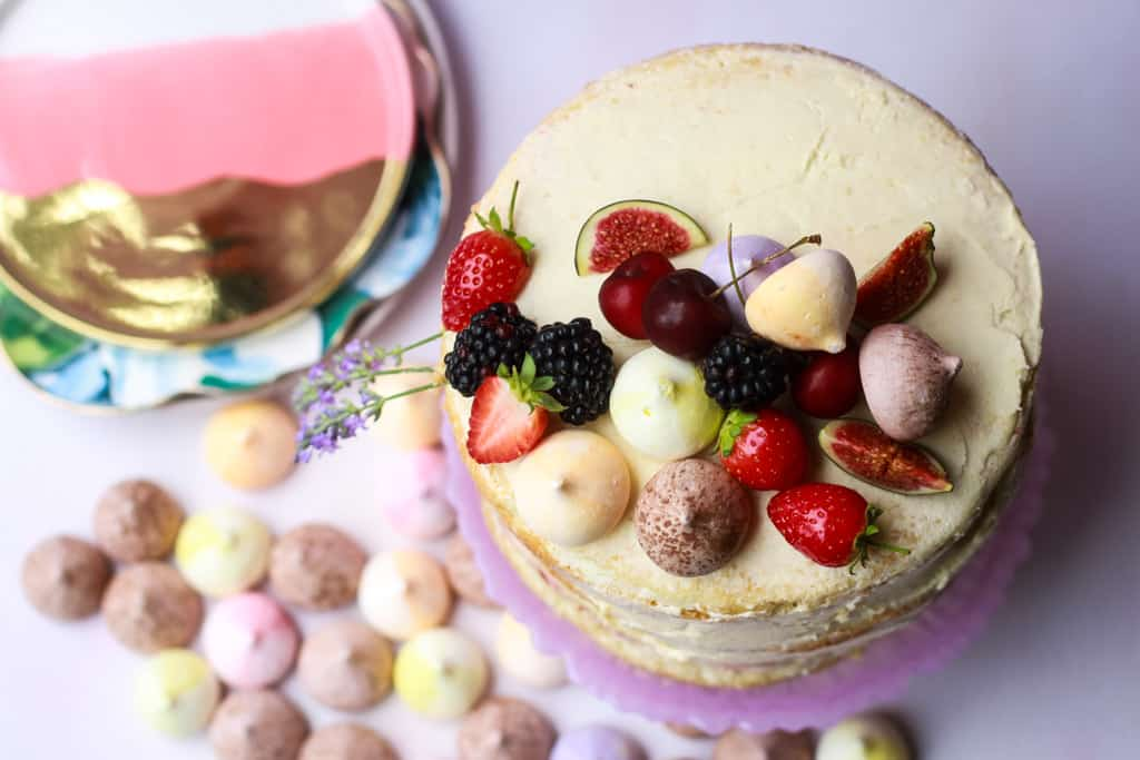 Overhead shot of a vanilla naked cake with mini meringues