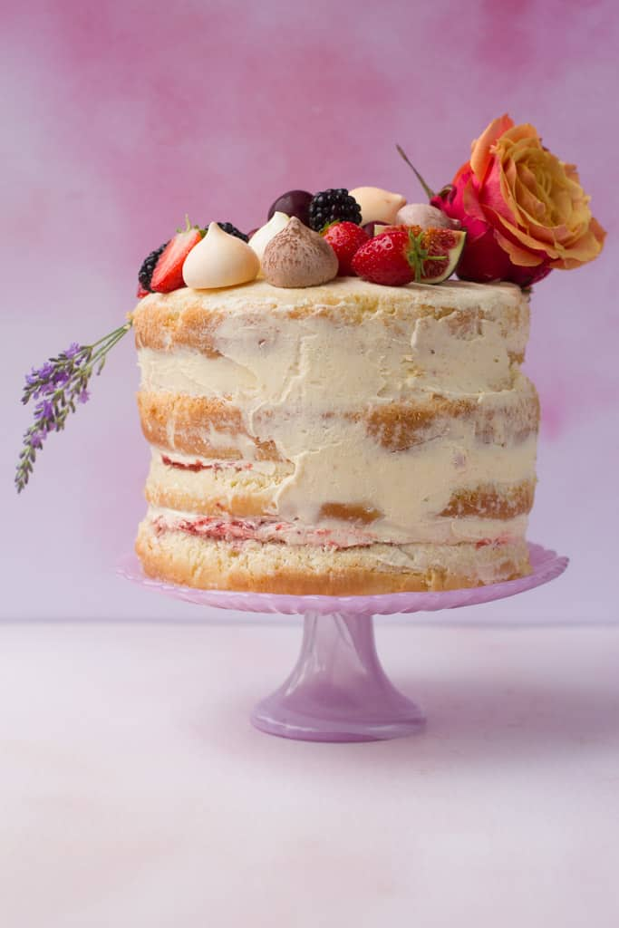Vanilla Naked Cake decorated with fruit, flowers and meringues