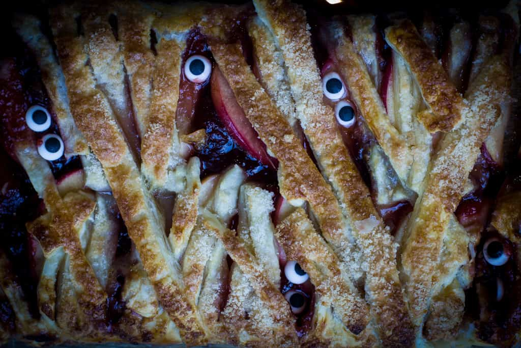 Overhead shot of a mummy aple pie with edible candy eyeballs poking out