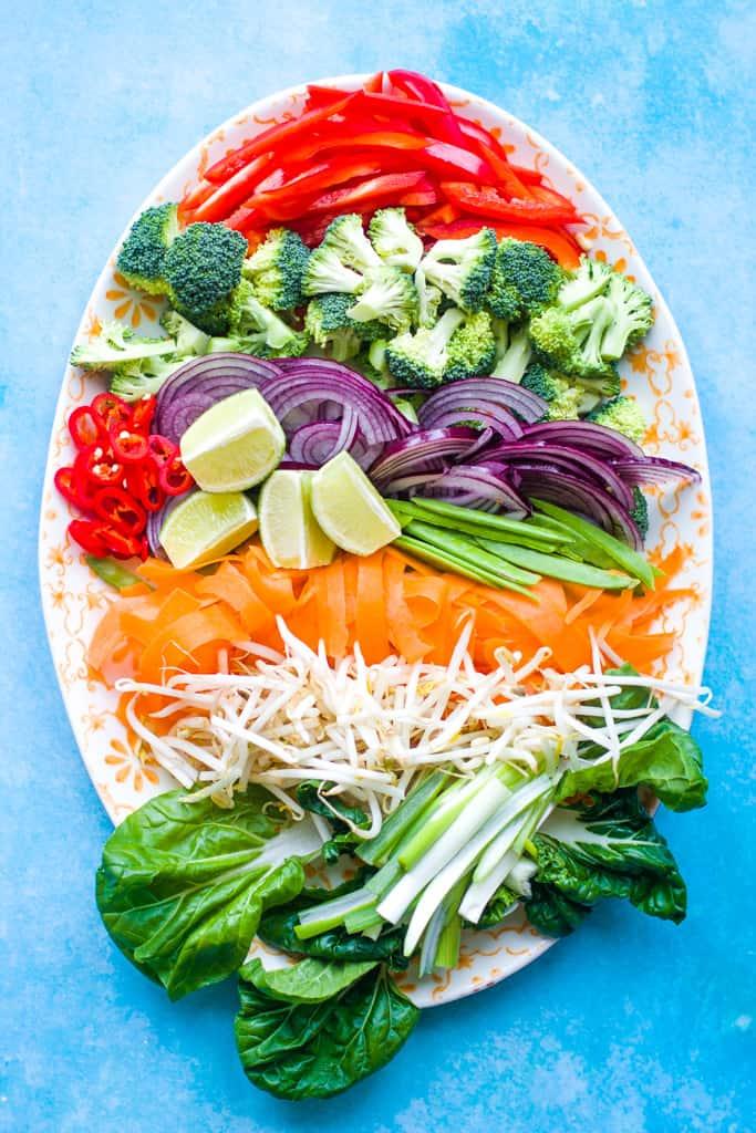 A platter with rainbow veggies for a vegetable teriyaki stir fry