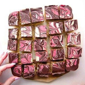A slab of millionaire caramel shortbread cut into individual slices