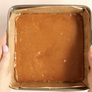 the caramel layer of a a millionaire caramel shortbread