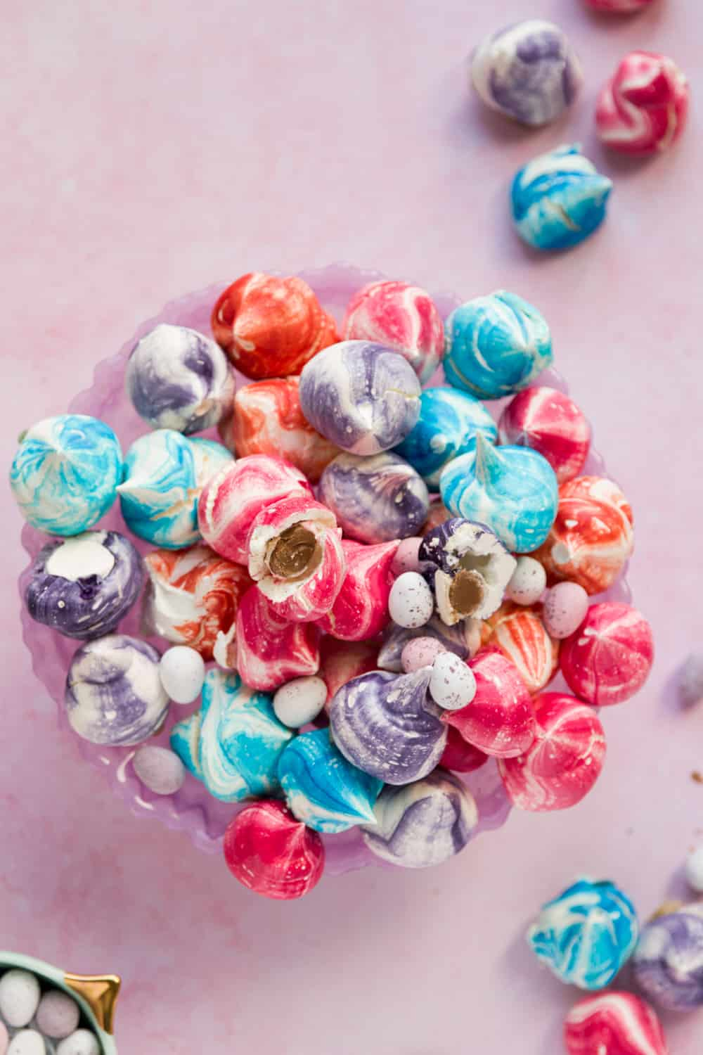 A platter full of mini meringues in various colours