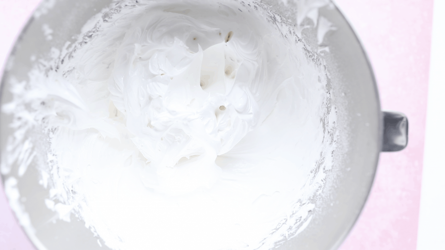 A bowl of thick and glossy meringue mixture.