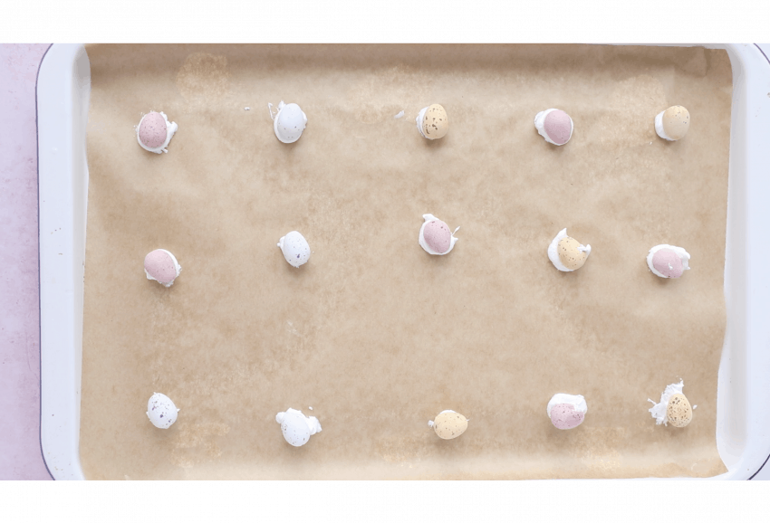 mini eggs stuck to a baking tray using meringue mixture