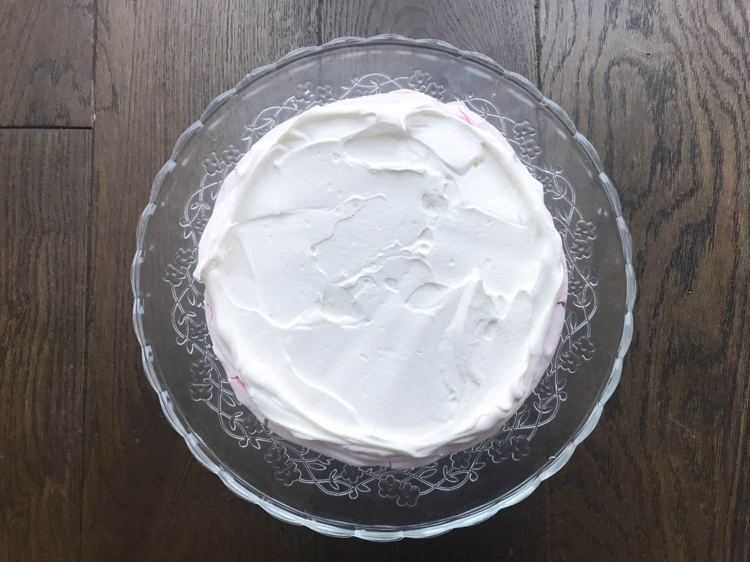 Whipped cream spread onto meringue