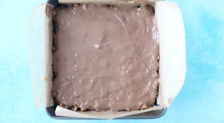 A Mars Bar slice uncut, in a pan