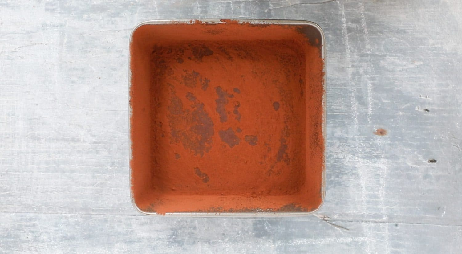 A baking pan with cocoa