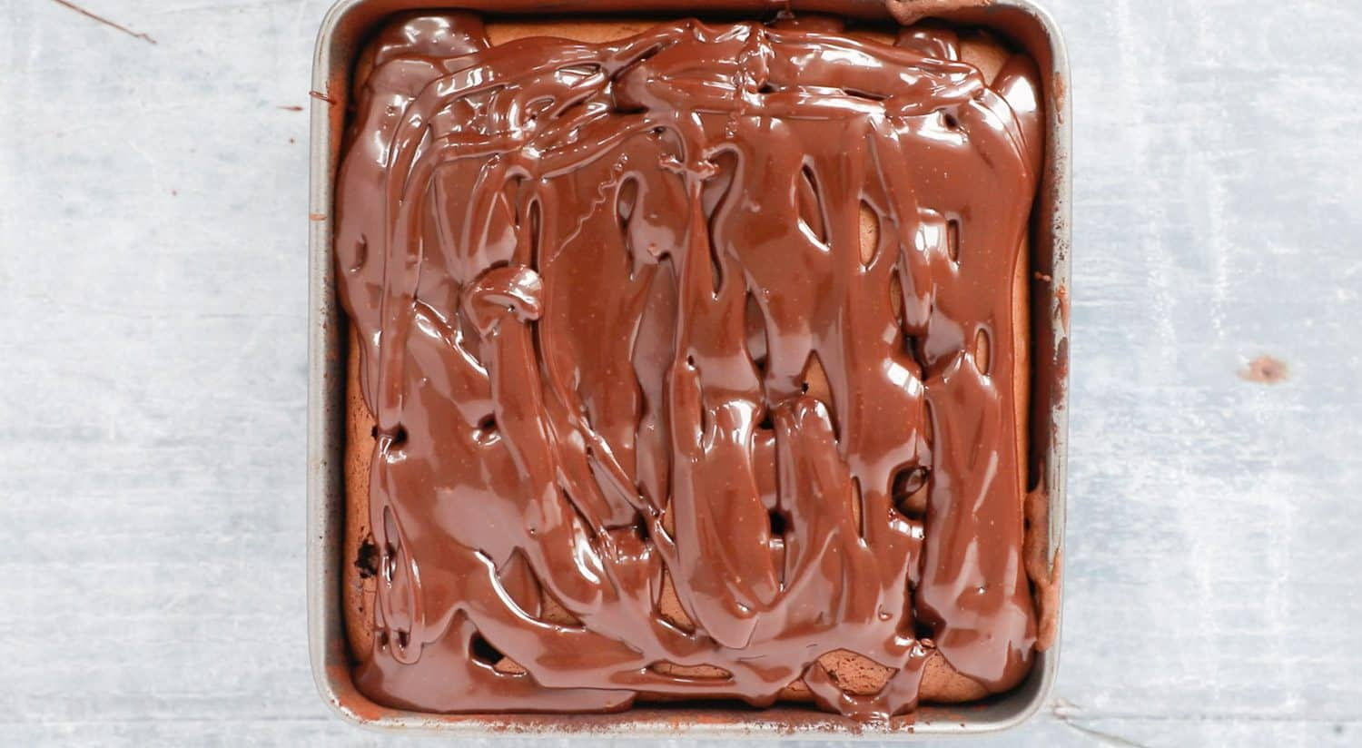 A cake with chocolate filling poured over it